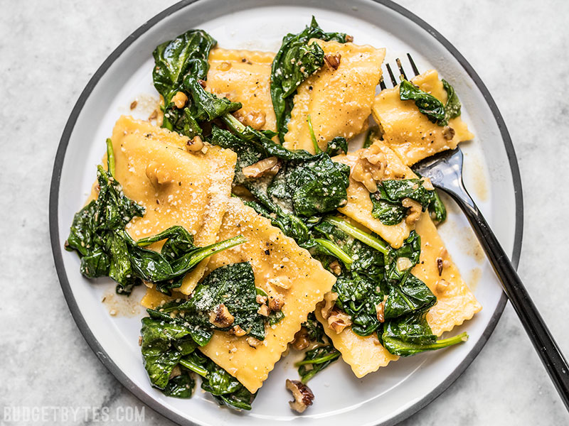 Ravioli with Sage Brown Butter Sauce, Spinach, and Walnuts
